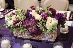 Round Wedding Table flowers eggplant | Tall arrangements with eggplant calla lily's, green hanging amaranthus ...