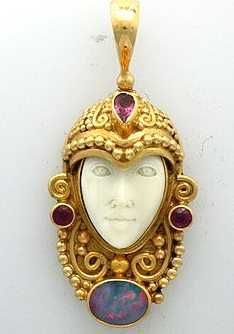 THIS IS AGORGEOUS 18K YELLOW GOLD SAJEN GODDESS CARVED FACE PENDANT WITH GREENTOURMALINES AND 1 BLACK OPAL. TOTAL WEIGHT OF THE RING IS 10.75 GRAMS