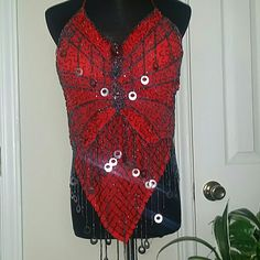 !!SALE!! Jazzy Red Halter Top Sizzling Hot Beaded top with tie around the neck and back.  Sexy and Jazzy for a night out on the town.  A must have!!!  NWOT fits Small to Medium. Tops Tank Tops