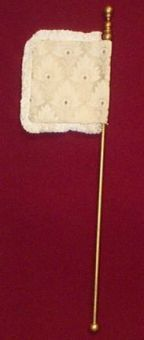 "The flag-shaped fan, also known as the ""key"" or ""weathercock"" fan became popular in Venice. Called the ""ventarola"" in Italy, these fans were constructed of plaited straw, parchment and brocaded fabric (often painted, beaded or embroidered). The darker colored, ornate fans were carried by matrons, while newly married or betrothed ladies carried white or ivory fans."