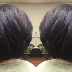"""I had so much fun this afternoon making over Barbara Martins hair!!  Refreshed her regrowth with Redkin color fusion 3N then strategically placed chunky highlights diagonally throughout the crown and sides and above the occipital bone in the back.  Then came back in with Joico Intensities ,peacock teal, cobalt blue, purple sapphire and magenta covering the highlights in 2"""" sections. This picture does not show the true beauty of this color! Hopefully I will get new photos tomorrow in natural…"""