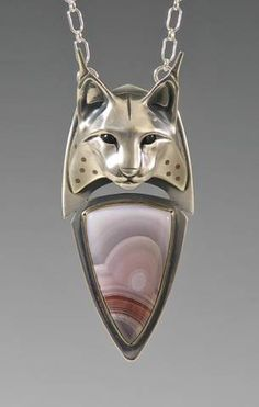Handcrafted Silver Jewelry by Brooke Stone: Silver Spotted Lynx - Cast silver, inlaid copper, Mexican Laguna agate, onyx.