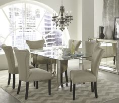An antique mirrored base makes this dining room set shine