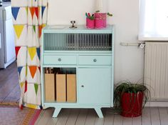 a beautiful blue painted vintage cabinet