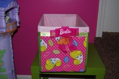 fabric+hot glue+diaper box= super easy storage bin for Ava's massive Barbie collection!