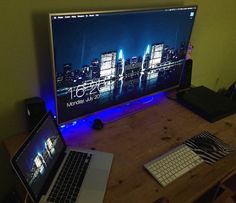 macbook pro with a tv display acoustics feng shui