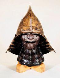 N EBOSHI-NARI KABUTO [HELMET IN THE FORM OF A COURT CAP] AND A MENPO. EDO PERIOD (17TH CENTURY)