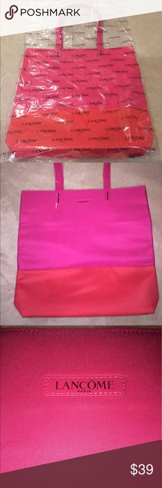 "NWT 2017 Lancôme large tote w/goodies NWT 2017 Lancôme large tote with Absolute Eye Premium rejuvenating eye cream and Absolute Premium Sunscreen SPF 15 replenishing cream. Tote is pink with orange bottom and measures approx 16 x 15"". Perfect for the summer! Everything brand new in original packaging. $150+ value.  Thanks for looking :) Lancome Makeup"