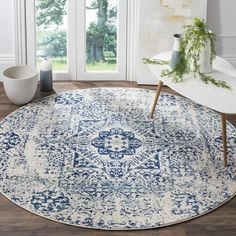 Anchor your dining room ensemble or add an elegant touch to the foyer with this lovely rug, showcasing a timeless Persian-inspired motif.