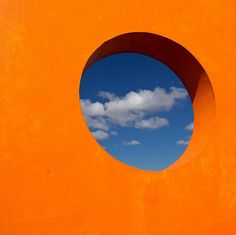 Orange wall with  portal to the sky