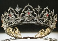 Prince Albert designed most of the tiaras that he gave Queen Victoria. He commissioned this one from Garrad's and paid £860. The tiara originally had over 2600 diamonds set in gold. Originally, underneath each arch glistened an opal, Prince Albert's favorite gemstone. When the Prince Consort died at the tender age of 41, the Queen dressed only in mourning black and never wore jewelry with colored stones again. No one saw the tiaras Prince Albert designed for almost half a century.