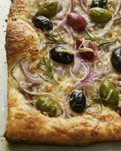 Sweet Paul's Red Onion & Olive Tart. Definately would like to try this. Maybe add spinach and remove the olives though