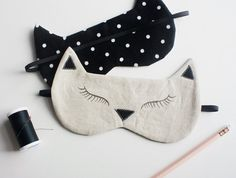 Perrrrrrfect gift for the crazy cat lady in your life!  Love this kitty sleeping mask!  https://www.etsy.com/listing/271371442/black-cat-sleeping-mask-unisex-sleep