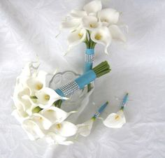 Calla lily wedding bouquet simple elegant Real touch mini white calla lily bridal bouquet  o Simple modern elegance. This beautiful hand tied bridal bouquet contains 31 real touch mini white calla lil