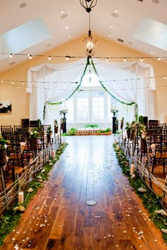 Details: lined wooden sticks to create a miniature fence, moss like grass, candles, rocks to create the walkway, wooden floors; Theme: rustic, modern, combination of outside and inside