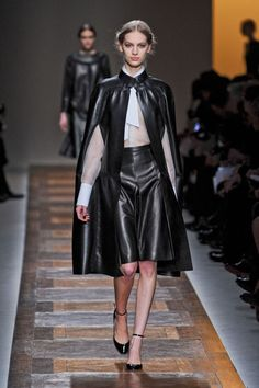 Style Trend: Maria Grazia Chiuri and Pier Paolo Piccioli picked up the black leather-strong woman thread and ran with it. Their fall collection both encapsulated the season's biggest trends and made it signature Valentino. This woman is a lady. Capital L. And she's feminine. Capital F.