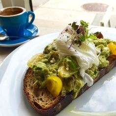 Avocado toast with poached egg @ Bluestone Lane Collective Cafe