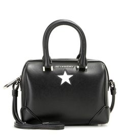 Givenchy - Lucrezia micro leather shoulder bag - Imposing with its signature front panels and durable corner covers, Givenchy's black calf leather shoulder bag is a sleek everyday choice. Subtle branding and a star motif in contrasting white give this design a fun finish. Lined in suede and roomy on the inside, this faultless piece will work from the office to evening events with ease. seen @ www.mytheresa.com