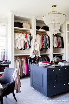 Alice Lane Home - Chic walk-in closet features a clear beaded tiered chandelier, Aerin Jacqueline Chandelier, illuminating a blue closet island accented with a black marble top with clear view to jewelry drawers. Dressing Room Closet, Closet Bedroom, Master Closet, Closet Space, Dressing Rooms, Closet Office, Huge Closet, Black Closet, Attic Closet