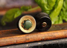 Ebony, jade and brass plugs.