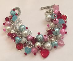 Handmade Valentine Charm Bracelet: Chunky Cluster Bracelet with Red, Pink and Light Blue Beads and Heart Charms by RoyalStreetBoutique on Etsy