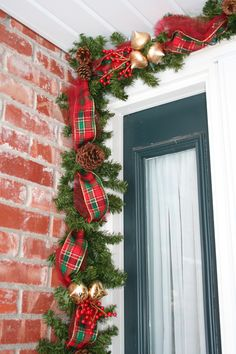 My version of the deco mesh garland. Lighted garland with tulle, ribbon, pine cones & ornaments. Around the front door at Christmas.