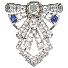 Art Deco Sapphire Diamond White Gold Brooch | From a unique collection of vintage brooches at http://www.1stdibs.com/jewelry/brooches/brooches/