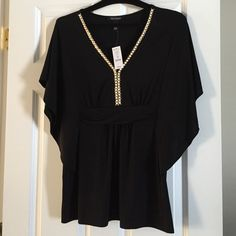 NWT White House Black Market studded top Brand new with tags!  Black flutter sleeved top with gold and cream studded trim. Stretchy to fit and flatter waistline. White House Black Market Tops