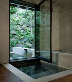 Indoor / outdoor tub...awesome!!! Love this concept!!! Would love a kid friendly version of this for our lanai that could extend into our back yard.