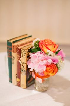 We used antique books, tulle, ribbon, and mason jars filled with peonies and roses for centerpieces.  The books were from our personal collection.  Ribbon and fabrics were purchased at Hobby Lobby on sale or with 40% off coupons as were the mason jars and I got the flowers downtown at the flower shops on Fannin.