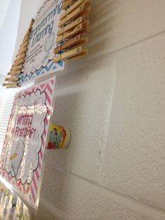 Use dixie cups to keep posters a little bit off the wall.  Good for various clip charts!   Sliding Into Second Grade: Show Off Your Space Linky!