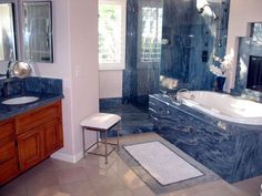Blue Bahia Granite On Vanity Top, Tub, And Shower.