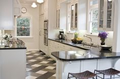 """""""Tom Newman's kitchen in his Los Angeles home that has now inspired two COCOCOZY readers to redo their own almost exactly the same."""" -- Click through for lots of pictures of the kitchens and THOSE FLOORS!!!  :-)"""