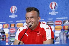 Xherdan Shaqiri of Switzerland laughs as he talks to the media during the Switzerland Press Conference at the Stade Bollaert-Delelis on June 10, 2016 in Lens, France.
