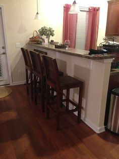 A great photo from of Nadeau bar stools; gorgeous in this kitchen!