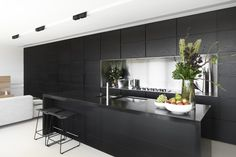 matte black on black kitchen with stainless steel