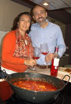 In Tudela (Navarra) at the home of Carlos Aliaga and his wife Mari Cruz with a tomatada (tomatoes, ham and snail stew from southern Navarra) made by Nabor Jimenez of Restaurante El Crucero, which was closed for vacation,  and a bottle of Aliaga Rosado de Lágrima de Garnacha (Garnacha Rosado made with free-run juice), October 8, 2014. A wine represented by The Spanish Artisan Wine & Spirits Group - Gerry Dawes Selections.  Photo by Gerry Dawes©2014 / gerrydawes@aol.com / Facebook / Twitter
