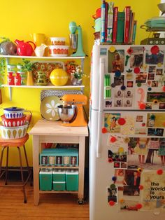 I love sunny happy kitchens that aren't taken so seriously!