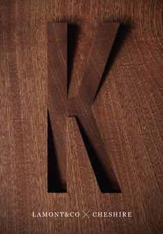 SKHY Apartments - K signage carved in wood
