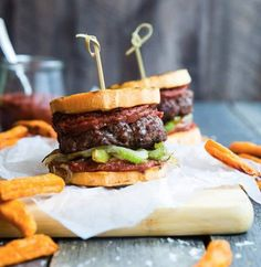 Delicious gluten and dairy free Cajun burgers prepared with Laura's Lean beef and grilled sweet potatoes as buns instead of bread!
