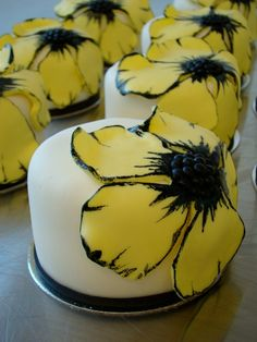 mini yellow and black cakes