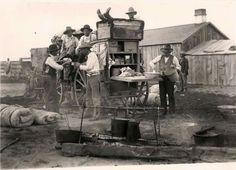 Cowboys having some fun and a coffee break around the Chuckwagon .