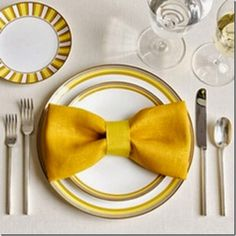 What an fun way to dress up your table for the holidays!See how to make this fun bowtie napkin fold and 20 plus other unique styles!