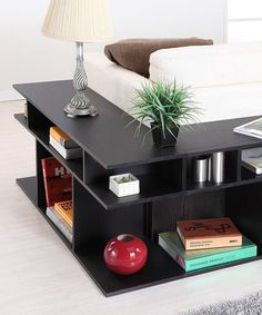 This is such a cool sofa table that wraps around the sectional! I have never seen that before!