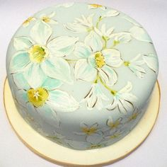 Beautiful, hand-painted cake with a soft, springy daffodil design on palest blue.