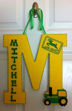 John Deere Nursery Lg letter Name Hanger. Personalized Homemade Nursery decor Wall letters kids door signs birth info plaques crib mobiles canvas art family name door hangers by Billie Landers Bamland Designs Charleston WV PayPal accepted. Mailing available. Come LIKE my page on Facebook http://m.facebook.com/BamlandDesignsCustomNurseryWallLettersMore