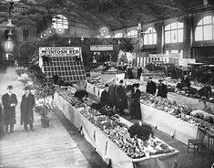 Fruit and flower stalls at the St. Lawrence Market, circa Image via City of Toronto Archives/Alexander W.