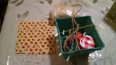 Purim shtetl - cardboard strawberry box, mini jam jar, small biscuit/cookie, tied with twine and covered with cloth square