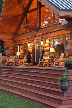 Rocking chairs on the porch of the log home!