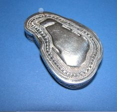 A rare and beautiful solid sterling hinged silver Sinhalese snuff/pill box. Beautifully crafted in the shape of the Island Ceylon showing water inlets.